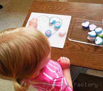 Valentine activities to match the hearts DIY milk bottle cap activity with free printable