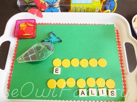 tray-set-up-with-markers-matched-to-some-letters