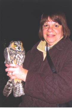 Carolyn-holding-long-eared-owl-at-Hawk-Ridge-in-Dulluth-MN