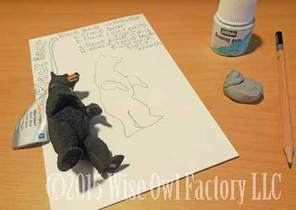 trace the black bear figurine on watercolor paper