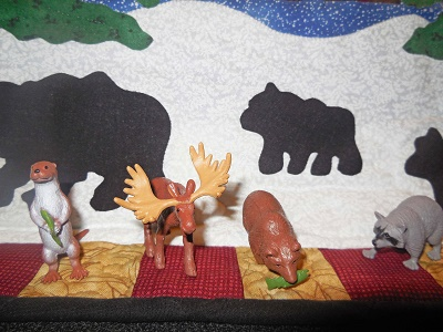 North-American-Wildlife-Toobs-toys-on-a-quilt-up-at-the-cabin