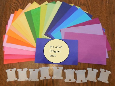 prepare materials by selecting paper color and having bobbins ready