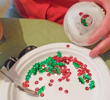 adding-sequins-to-glue-inside-plastic-globe-ornament