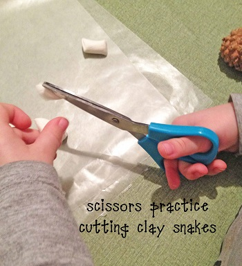 scissors-practice-cutting-clay-snakes