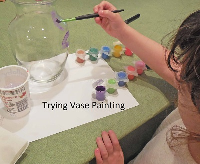 trying her hand at vase painting