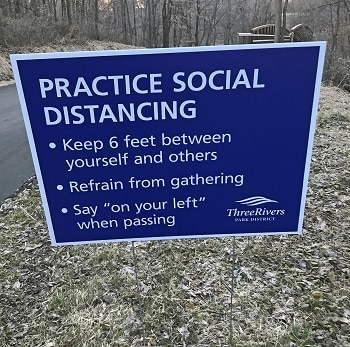 practice-social-distancing-sign-near-Maple-Grove-Arboretum
