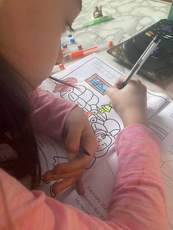 Chloe-coloring-the-pandemic-book-with-gel-pens