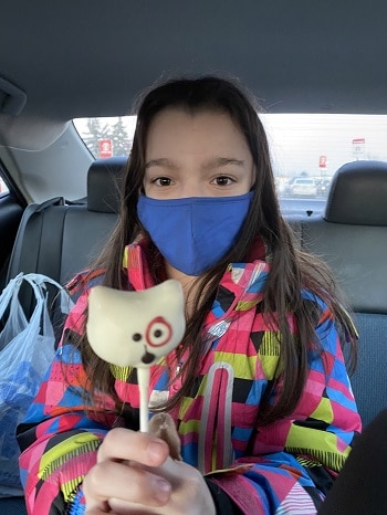 Miss-Owl-riding-home-with-a-cake-pop-how-is-she-supposed-to-eat-with-a-mask